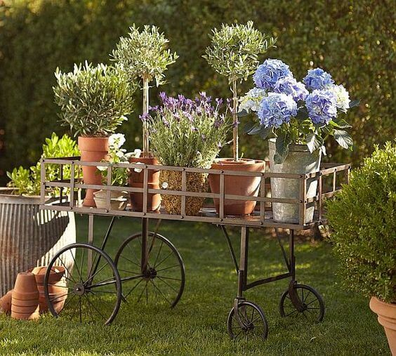 wooden garden cart with flower pots
