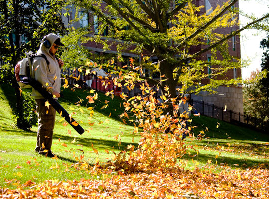 someone showing how to use leaf blowers