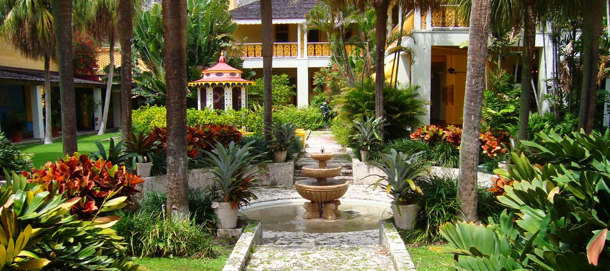 garden with palm trees and fountain