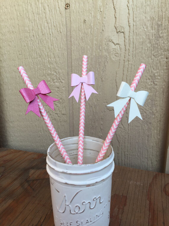 colorful straws decorated with bows for a garden party