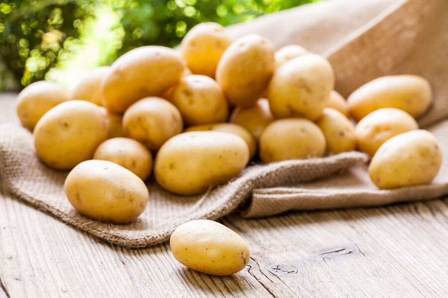 potato pile on wooden surface
