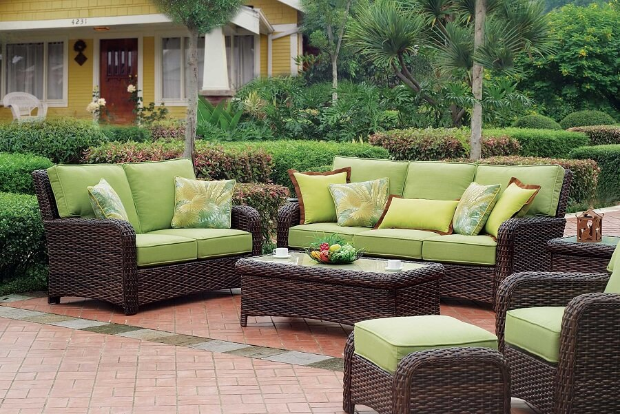 rattan garden furniture set with green cushions