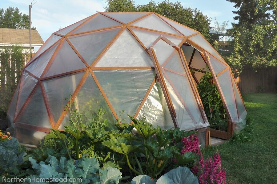 round greenhouse covered with plastic sheeting