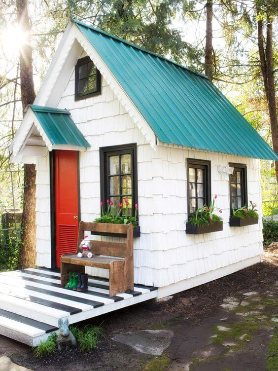 backyard shed that resembles a miniature house