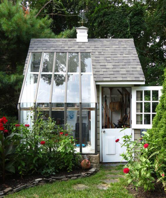 backyard shed with glass window that covers the roof as well