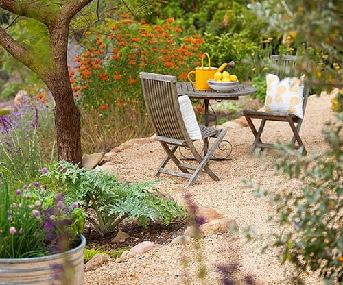 gravel paved sitting area in a garden