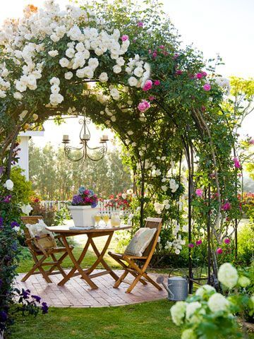 garden seating area covered by flower arches