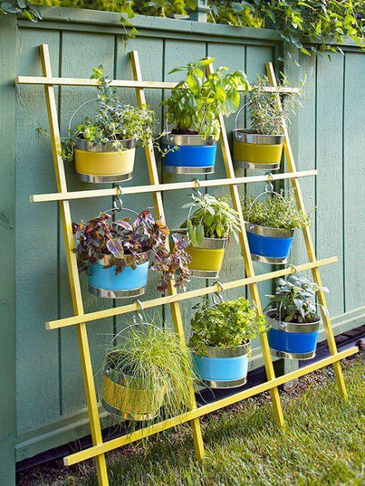 flower pots hanging from a trellis