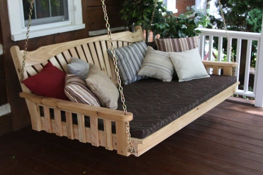 porch swing decorated with multiple pillows