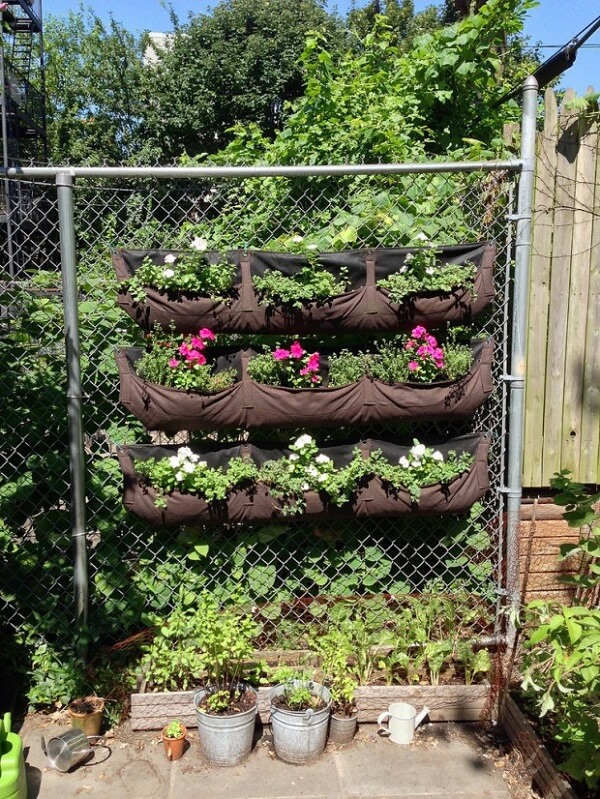flower pouches hanging from a fence