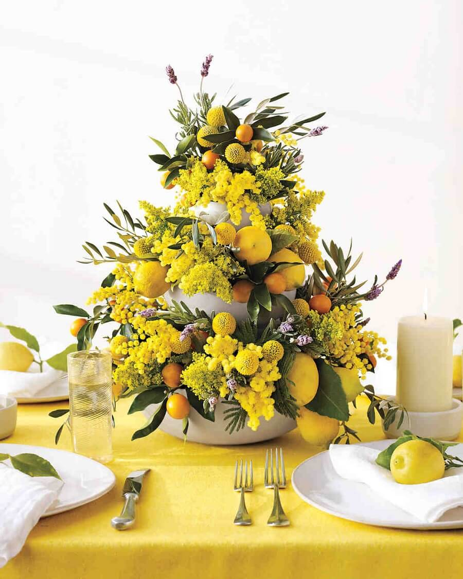 yellow wedding centerpiece with flowers and citrus