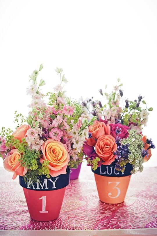 two flower pots serving as wedding centerpieces and favors