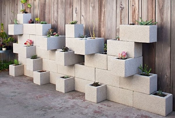 concrete blocks being used as flower pots