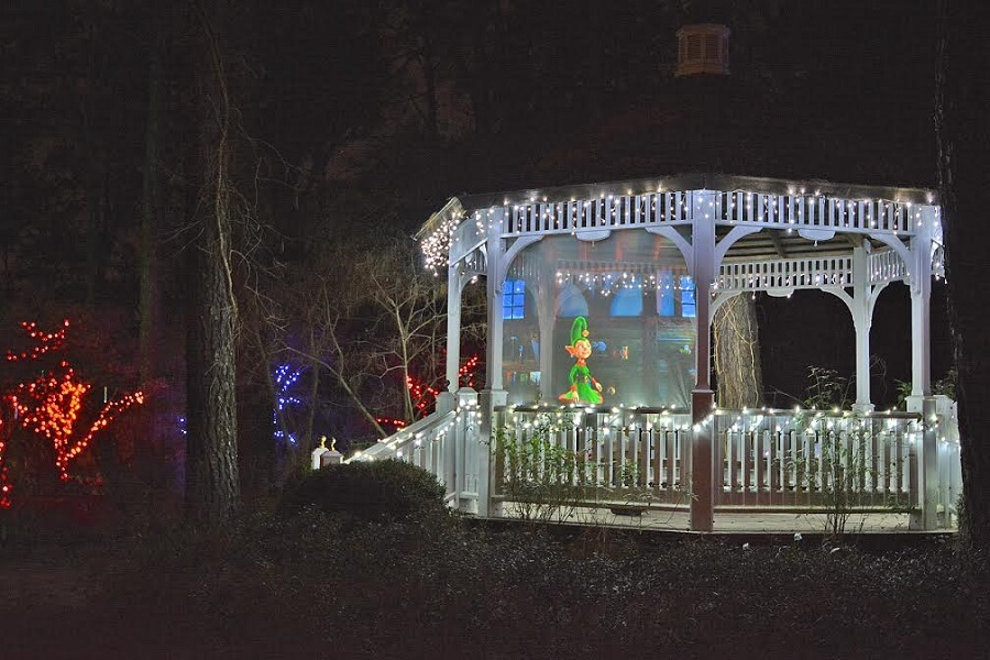 arbour decorated with fairy lights and an elf