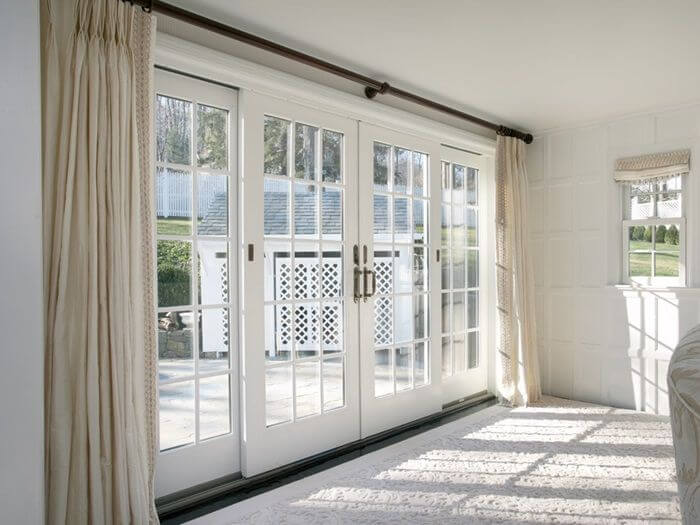 white patio door with beige curtains