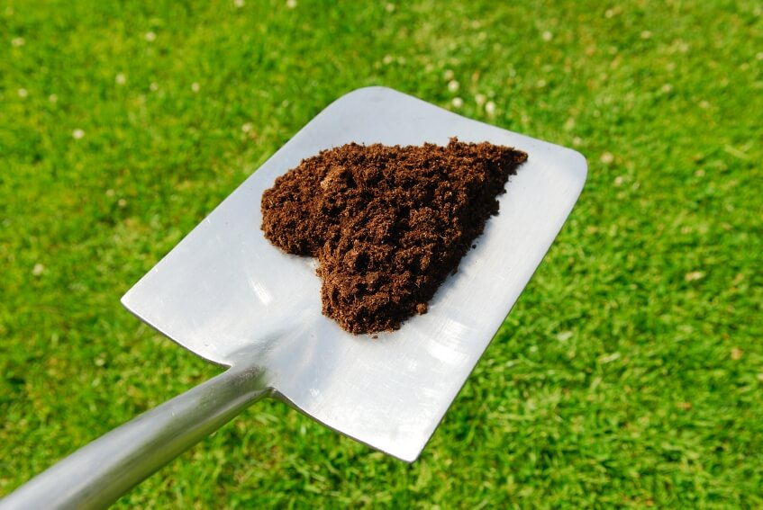 compost in the shape of a heart on a shovel