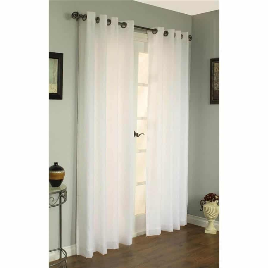patio door with ivory curtains
