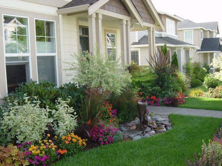 house with a tidy front yard landscape