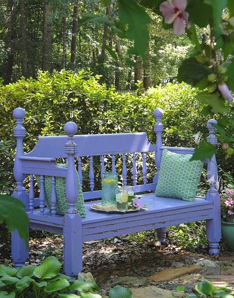blue wood garden bench with decorative pillows