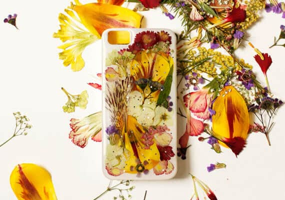 white phone case decorated with pressed flowers
