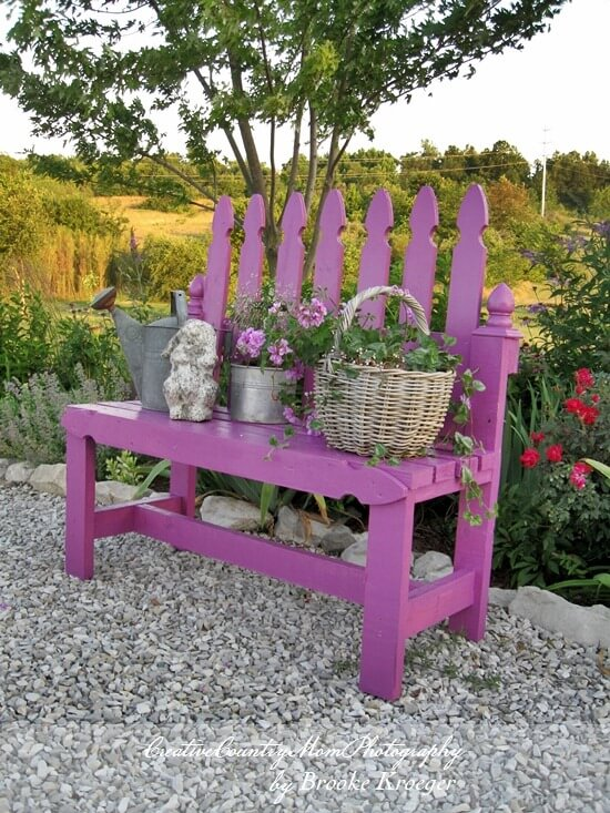 purple wood garden bench with decorative items