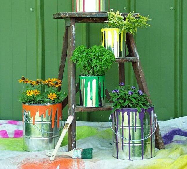 flowers growing from paint cans, garden planters diy