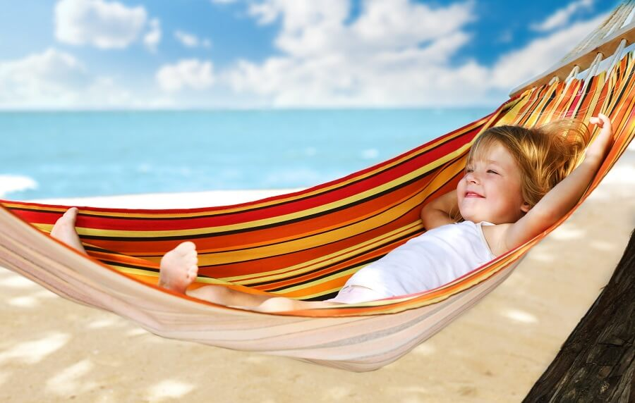 happy child lying in a hammock