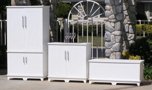 three white cabinets sitting outside