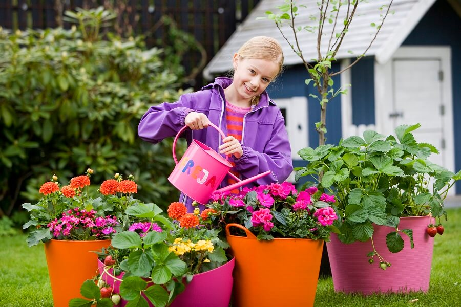 little girl watering some flowers, gardening lesson plans