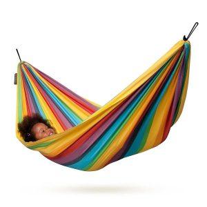 girl sitting in a rainbow hammock