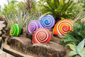 snails made of concrete in a garden