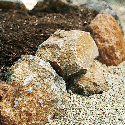 rocks forming a raised garden bed