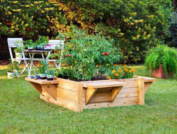 benches attached to a raised garden bed