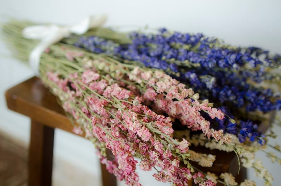 two bouquets of dried flowers