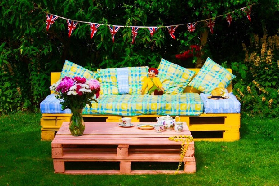 repurposed materials, garden furniture set made of wooden pallets and colorful pillows