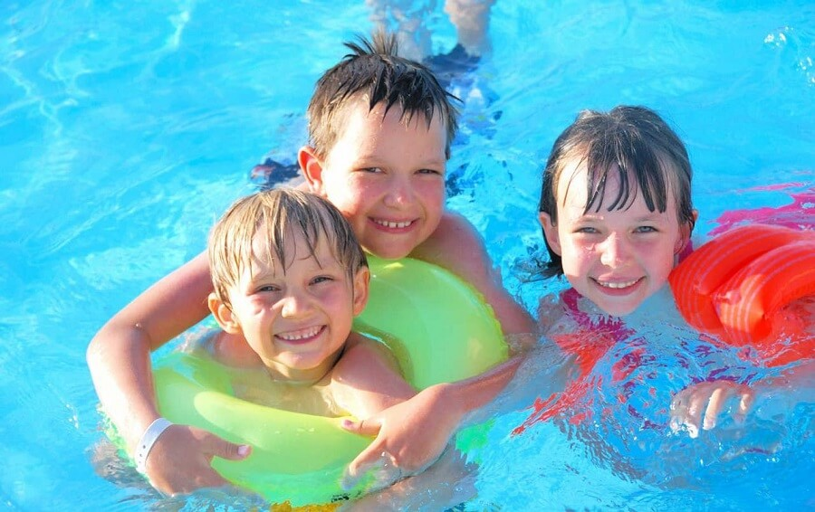 three children in a pool, poolscaping