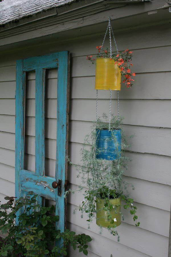 hanging planter made of tin cans