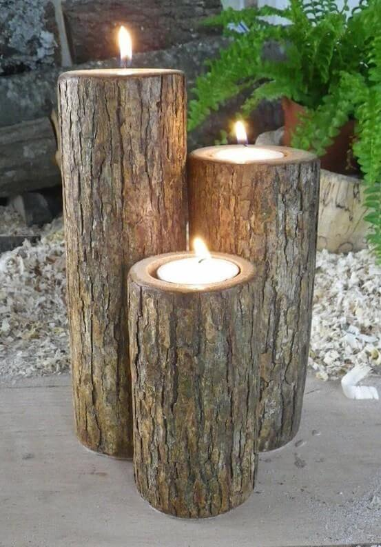 logs serving as candle holders, repurposed materials