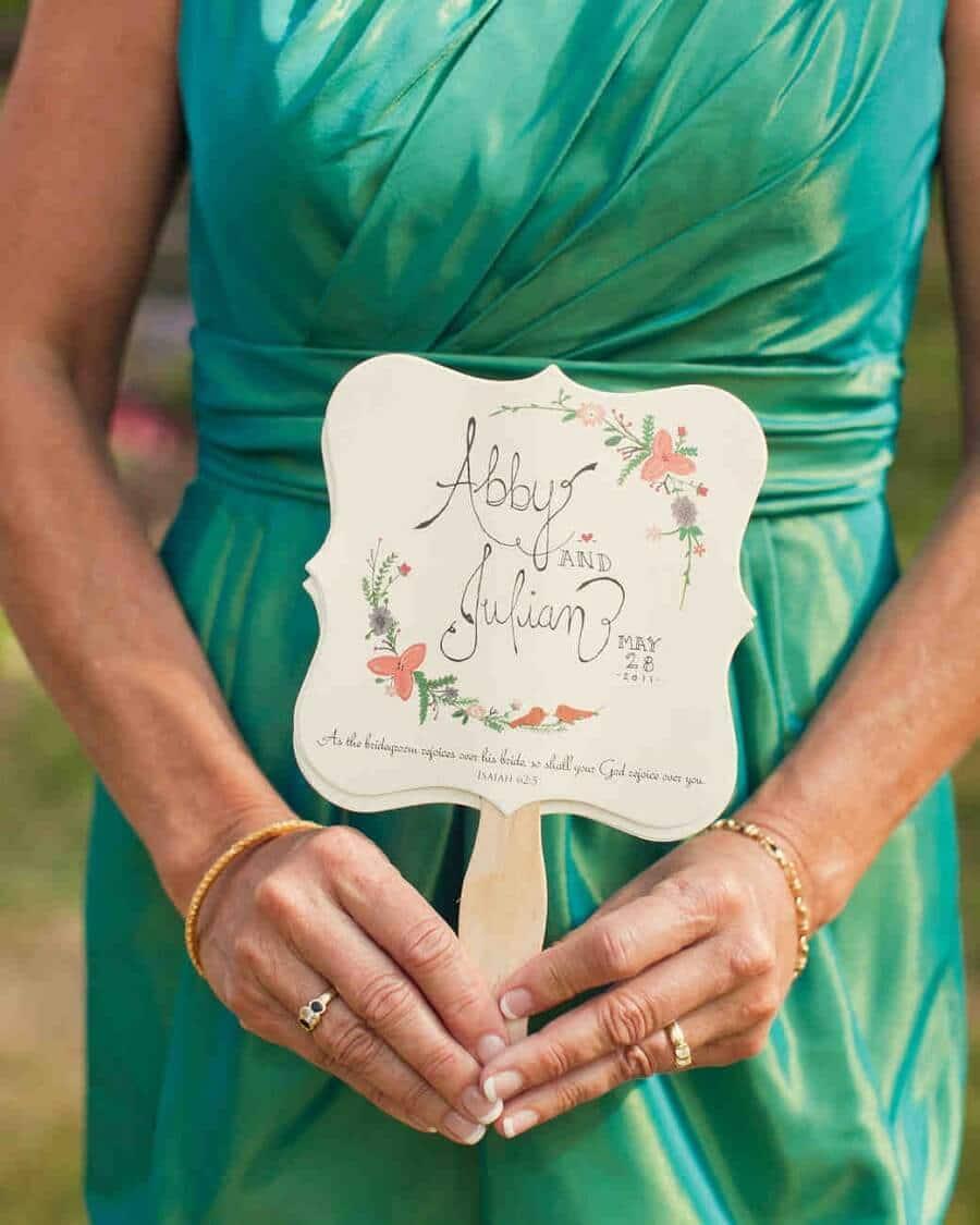 someone holding a wedding program
