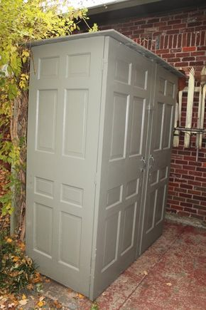 shed made of old doors, repurposed materials