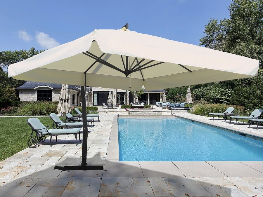 white umbrella next to a pool