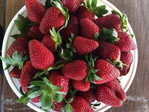 plate full of strawberries