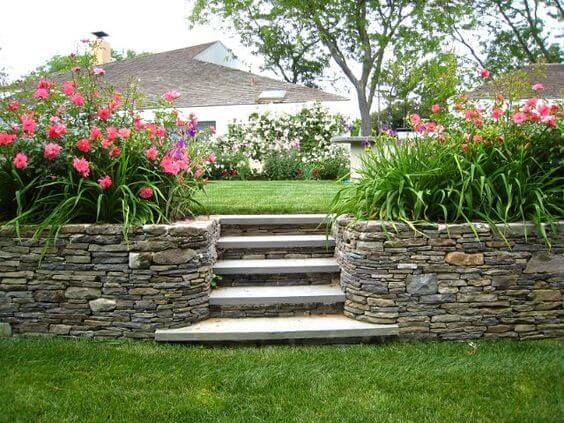 garden entrance framed by two dry stack stone walls