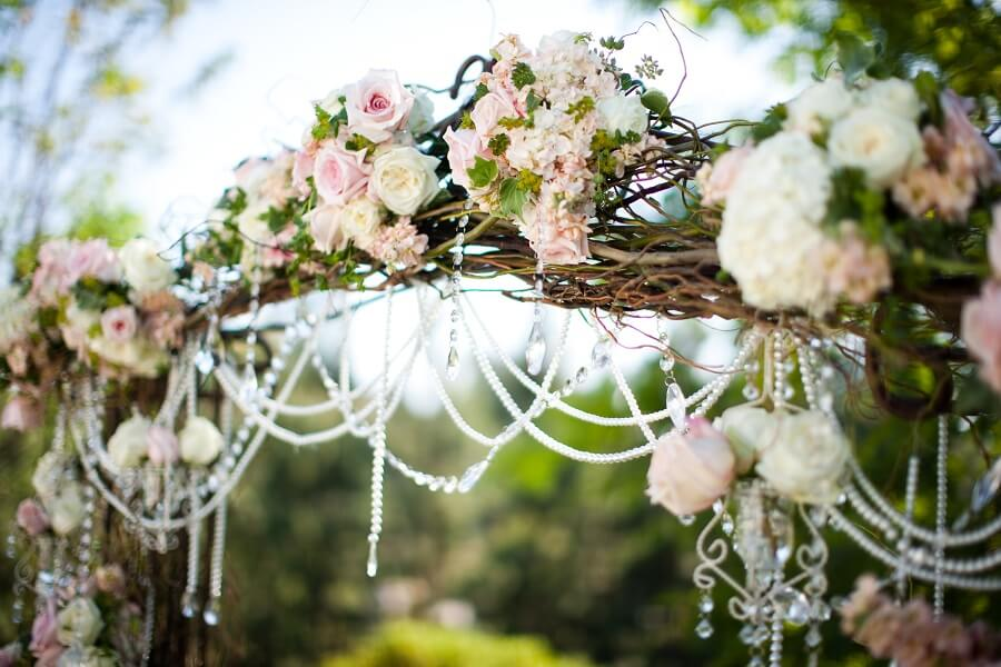 flowers on a wedding trellis