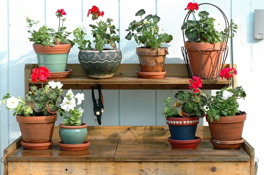 potting bench with pots on it