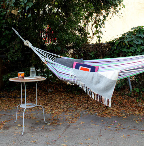 hammock next to a table in the garden