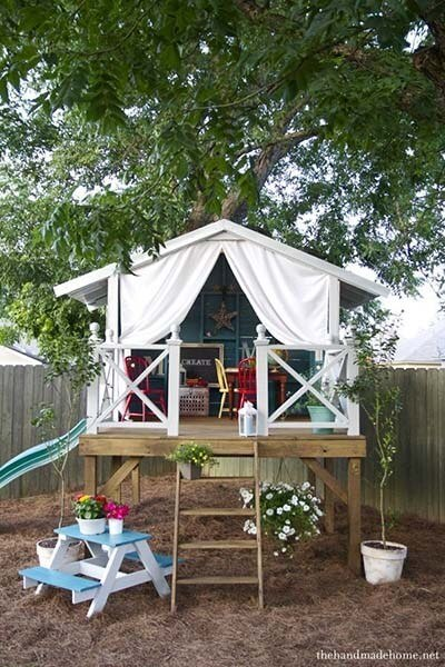 large playhouse in a tree