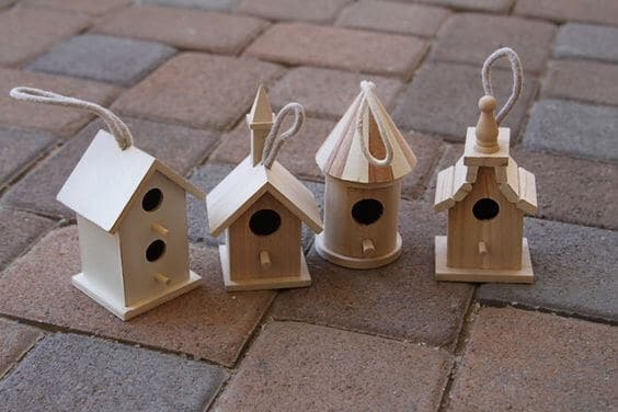 Wooden birdhouses on the ground