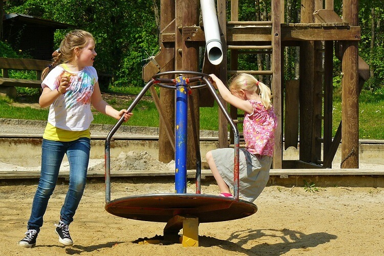 Girls playing at a playground