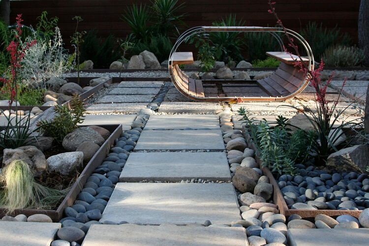 Backyard landscape idea with pavers and stones